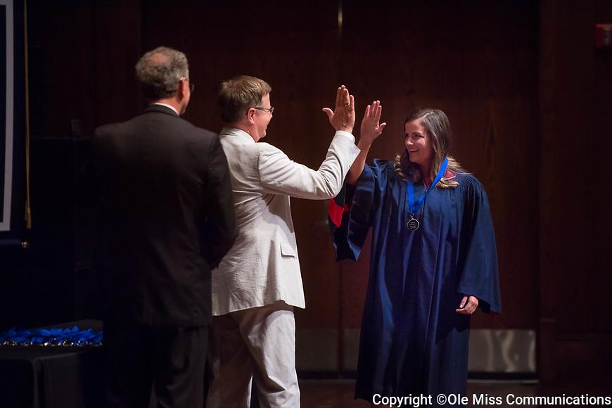 SMBHC senior Bess Nichols gives Chancellor Vitter a celebratory greeting at Friday night's senior presentation.  Photo by Kevin Bain/Ole Miss Communications