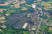 Kraftwerk Ibbenbüren: DEUTSCHLAND, NIEDERSACHSEN, IBBENBUEREN (GERMANY), 22.05.2017: Das Kraftwerk Ibbenbüren wurde ab Juli 1981 errichtet und hatte ursprünglich eine Leistung von 808 Megawatt, seit der Revision 2009 von 848 Megawatt. Das Kraftwerk mit seinem 275 Meter hohen Kamin ging am 19. Juni 1985 in Betrieb und ist ein Grund- und Mittellastkraftwerk.<br /> Versorgt wird das Kraftwerk hauptsächlich mit Anthrazitkohle aus der benachbarten Zeche Ibbenbüren im Tecklenburger Land. Diese Kohle ist sehr hart und macht eine Schmelzkammerfeuerung notwendig. Der Kessel des Kraftwerks in Ibbenbüren ist der größte Schmelzkammerkessel der Welt (Stand 2005). Jährlich werden circa 1,4 Mio. Tonnen Anthrazitkohle im Kraftwerk verstromt.<br /> <br /> Ende der 1980er Jahre wurde das Kraftwerk mit der zu diesem Zeitpunkt modernsten Filtertechnik und Anlagen zur Rauchgasentschwefelung ausgerüstet. Das Kraftwerk beschäftigt derzeit 140 Menschen. Der Betreiber des Kraftwerks ist die RWE Generation SE.