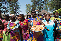 Africa, DRC, Democratic Republic of the Congo, South Kivu, Kamanyola. Women for Women project. WFW Kamanyola co-op and lifeskills training. Women dancing in greeting and their Belgium waffles.