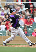 Ty Wigginton #21 of the Colorado Rockies plays in a spring training game against the Arizona Diamondbacks at Salt River Fields on February 26, 2011  in Scottsdale, Arizona. .Photo by:  Bill Mitchell/Four Seam Images.