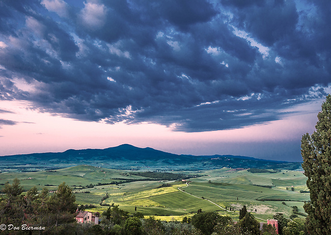 Early morning clouds clearing over the Val d' Orcia as viewed from Pienza,  in Tuscany, Italy.