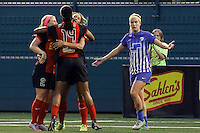 Rochester, NY - Friday May 27, 2016: Western New York Flash midfielder Michaela Hahn (2) and forward Jessica McDonald (14) celebrate a goal by forward Lynn Williams (9) as Boston Breakers defender Christen Westphal (21) looks on. The Western New York Flash defeated the Boston Breakers 4-0 during a regular season National Women's Soccer League (NWSL) match at Rochester Rhinos Stadium.