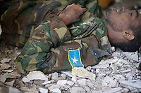 Al-shabaab militant, dressed in Somali national Army fatigues, lay dead on the floor after the siege.