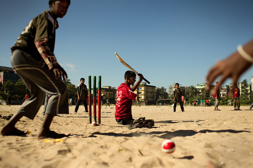 15-year-old Mohammad Sharif, center, bats during a cricket practice match in Chittagong, Bangladesh.