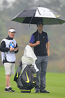 Ross Fisher (ENG) with caddy Mark Sherwood on the 3rd hole during Thursday's Round 1 of the 2014 BMW Masters held at Lake Malaren, Shanghai, China 30th October 2014.<br /> Picture: Eoin Clarke www.golffile.ie