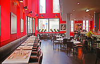 Restaurant Le Café du Théâtre. modern stylish restaurant in the old town in Bordeaux. Bright red painted walls and black leather chairs. People sitting in the bar drinking. Bordeaux City, Bordeaux Gironde Aquitaine France Europe