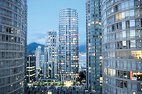 A view of the vancouver high-rises with the mountains and bay visible in the early evening light. British Colombia, Canada 06-02
