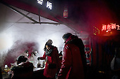 Street stalls erect on the edge of a central Chinese city where rural residents who have lost their land come to eat. <br /> <br /> China is pushing ahead with a dramatic, history-making plan to move 100 million rural residents into towns and cities over six years &mdash; but without a clear idea of how to pay for the gargantuan undertaking or whether the farmers involved want to move.<br /> <br /> Moving farmers to urban areas is touted as a way of changing China&rsquo;s economic structure, with growth based on domestic demand for products instead of exporting them. In theory, new urbanites mean vast new opportunities for construction firms, public transportation, utilities and appliance makers, and a break from the cycle of farmers consuming only what they produce.<br /> <br /> Urbanization has already proven to be one of the most wrenching changes in China&rsquo;s 35 years of economic reforms. Land disputes rising from urbanization account for tens of thousands of protests each year.