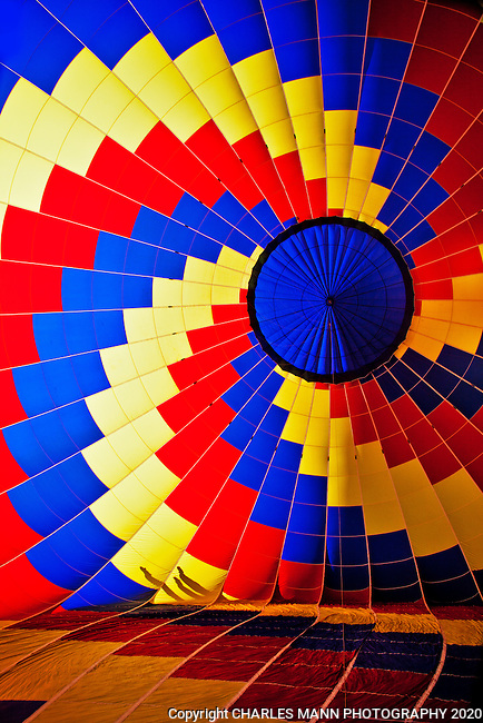The opening day of the 2013 Albuquerque Hot Air Balloon Fiesta featured over 500 hot air balloons and  a thousands of spectators who wandered among the balloons as they began to ascend into the sky.
