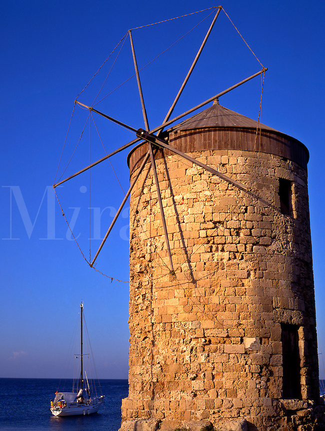 Greece. Dodecanese Islands. Rhodes..Windmill in Mandraki Harbor.