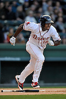 First baseman Josh Ockimey (18) of the Greenville Drive runs toward first base in a game against the Asheville Tourists on Thursday, April 7, 2016, at Fluor Field at the West End in Greenville, South Carolina. Greenville won, 4-3. (Tom Priddy/Four Seam Images)