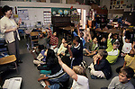Berkeley CA 3rd grade teacher engaging eager students in discussion in class
