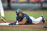 Michigan Wolverines designated hitter Jordan Nwogu (42) looks up towards the umpire after diving back to first base during Game 6 of the NCAA College World Series against the Florida State Seminoles on June 17, 2019 at TD Ameritrade Park in Omaha, Nebraska. Michigan defeated Florida State 2-0. (Andrew Woolley/Four Seam Images)