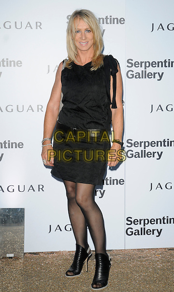 KAREN MILLEN .At the Serpentine Gallery Summer Party, Serpentine Gallery, Hyde Park, London, England, UK, July 8th 2010..full length black dress tights ankle boots open toe belt peep .CAP/CAN.©Can Nguyen/Capital Pictures.