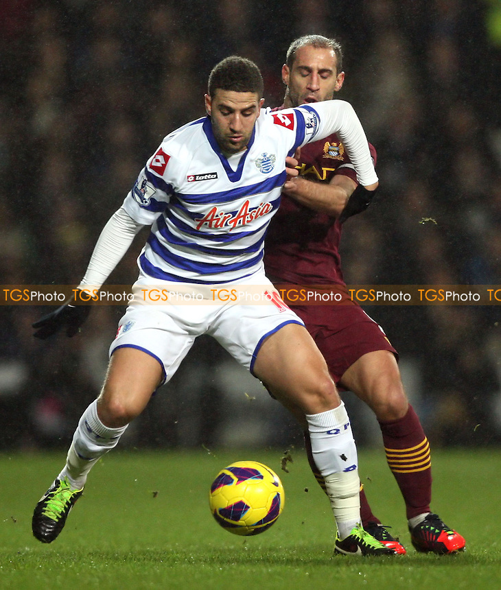 Adel Taarabt of QPR and Pablo Zabaleta of Man City - Queens Park Rangers vs Manchester City, Barclays Premier League at Loftus Road, London - 29/01/13 - MANDATORY CREDIT: Rob Newell/TGSPHOTO - Self billing applies where appropriate - 0845 094 6026 - contact@tgsphoto.co.uk - NO UNPAID USE.