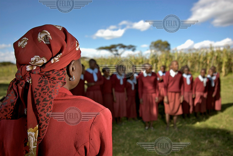 Anne Nakora, local teacher at the Olo Kuseroi village school, sings traditional songs with the children....