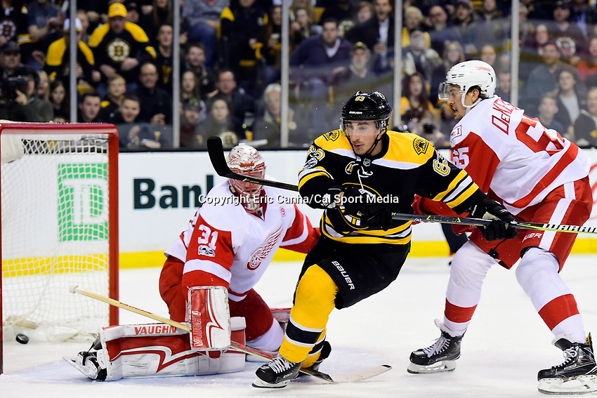 Wednesday, March 8, 2017: Boston Bruins left wing Brad Marchand (63) scores a first period goal against Detroit Red Wings goalie Jared Coreau (31) during the National Hockey League game between the Detroit Red Wings and the Boston Bruins held at TD Garden, in Boston, Mass. Eric Canha/CSM