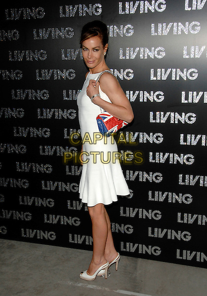 TARA PALMER-TOMKINSON.Living TV - Summer Schedule Launch.Old Truman Brewery, Brick Lane.10th May 2007 London, England.full length white dress sleeveless blue red bag union jack purse palmer tomkinson peep toe shoes slingback .Ref: CAP/PL.©Phil Loftus/Capital Pictures.