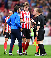 Lincoln City manager Danny Cowley, left, speaks to Referee Gavin Ward at the final whistle<br /> <br /> Photographer Chris Vaughan/CameraSport<br /> <br /> The EFL Sky Bet League Two - Lincoln City v Morecambe - Saturday August 12th 2017 - Sincil Bank - Lincoln<br /> <br /> World Copyright &copy; 2017 CameraSport. All rights reserved. 43 Linden Ave. Countesthorpe. Leicester. England. LE8 5PG - Tel: +44 (0) 116 277 4147 - admin@camerasport.com - www.camerasport.com