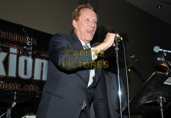 Actor James Woods attends 'A Conversation With James Woods' presented by CARSTAR Automotive Canada Inc. in support of Cystic Fibrosis Canada at Carmen's Banquet and Convention Centre, Hamilton, Ontario, Canada..November 20th, 2011.half length black suit grey gray tie white shirt microphone  hand.CAP/ADM/BPC.©Brent Perniac/AdMedia/Capital Pictures.
