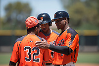 San Francisco Giants Orange catcher Andres Angulo (7) talks to Anyesber Sivira (32) during an Extended Spring Training game against the Seattle Mariners at the San Francisco Giants Training Complex on May 28, 2018 in Scottsdale, Arizona. (Zachary Lucy/Four Seam Images)