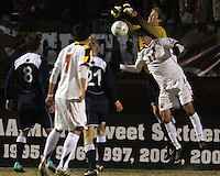 John Stertzer #27 of the University of Maryland has the ball punched away from him by Brendan Birmingham #28 of Penn State during an NCAA 3rd. round match at Ludwig Field, University of Maryland, College Park, Maryland on November 28 2010.Maryland won 1-0.