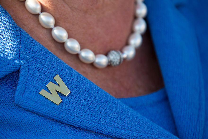 A supporter wears a W pin at the dedication of the George W. Bush presidential library on the campus of Southern Methodist University in Dallas.