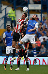 Chris Basham of Sheffield Utd challenges Steven Fletcher of Sheffield Wednesday during the Championship match at the Hillsborough Stadium, Sheffield. Picture date 24th September 2017. Picture credit should read: Simon Bellis/Sportimage