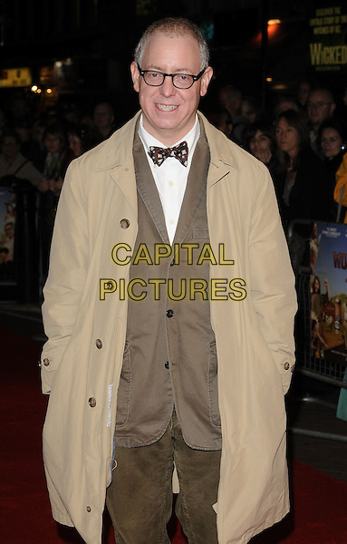 "JAMES SCHAMUS - producer .Attending the ""Taking Woodstock"" Gala Screening during the Times BFI 53rd London Film Festival, Vue West End cinema, Leicester Square, London, England, UK, 26th October 2009..half length glasses brown beige mac coat suit bow tie hands in pockets jacket .CAP/CAN.©Can Nguyen/Capital Pictures"