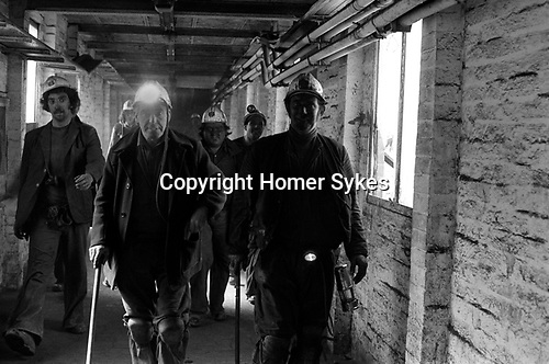 Miners coming off their shift. South Kirkby Colliery, Yorkshire England. Coal Miners story 1979. Opened in 1881, closed in 1988. Miner with lamp alight is Frank Hunt Seam overman. Miner on extreme right is Bill Allen a Pit official<br />