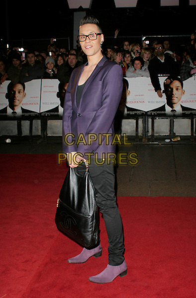 "GOK WAN .Attending the UK Film Premiere of ""Seven Pounds"" at the Empire Cinema, Leicester Square, London, England, January 14th 2009..full length purple jacket blazer black oversized Chanel tote bag suede shoes boots glasses  .CAP/AH.©Adam Houghton/Capital Pictures"