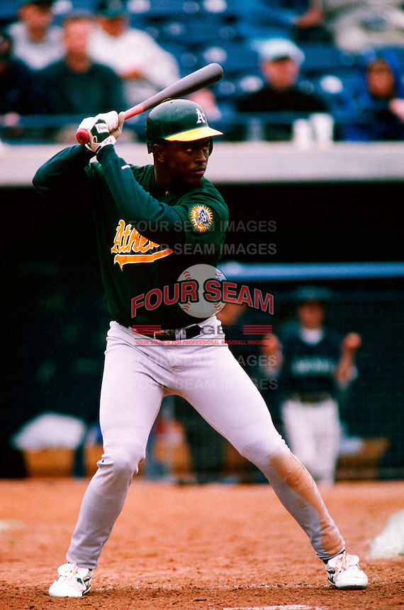 Mario Encarnacion of the Oakland Athletics participates in a Major League Baseball Spring Training game during the 1998 season in Phoenix, Arizona. (Larry Goren/Four Seam Images)