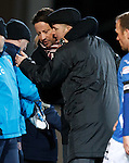 Paulo Sergio and Steve Lomas after the match sharing a cheeky hug