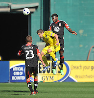 Ben Speas (17) of The Columbus Crew heads the ball against Brandon McDonald (4) of D.C. United. The Columbus Crew defeated D.C. United  2-1, at RFK Stadium, Saturday March 23, 2013.