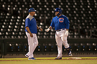 AZL Cubs 1 catcher Alexander Guerra (6) is congratulated by manager Carmelo Martinez after reaching third base during an Arizona League game against the AZL Diamondbacks at Sloan Park on June 18, 2018 in Mesa, Arizona. AZL Diamondbacks defeated AZL Cubs 1 7-0. (Zachary Lucy/Four Seam Images)