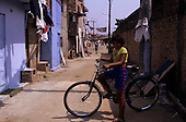 Sao Paulo, Brazil. Favela Vila Prudente; child on a bicycle.