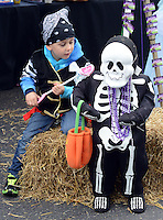 Stephen Nagel, 4 of Quakertown, Pennsylvania dressed as a pirate plays with a skeleton during the Autumn Alive Festival Saturday October 17, 2015 at Ferry Street Park in Quakertown, Pennsylvania.  (Photo by William Thomas Cain)