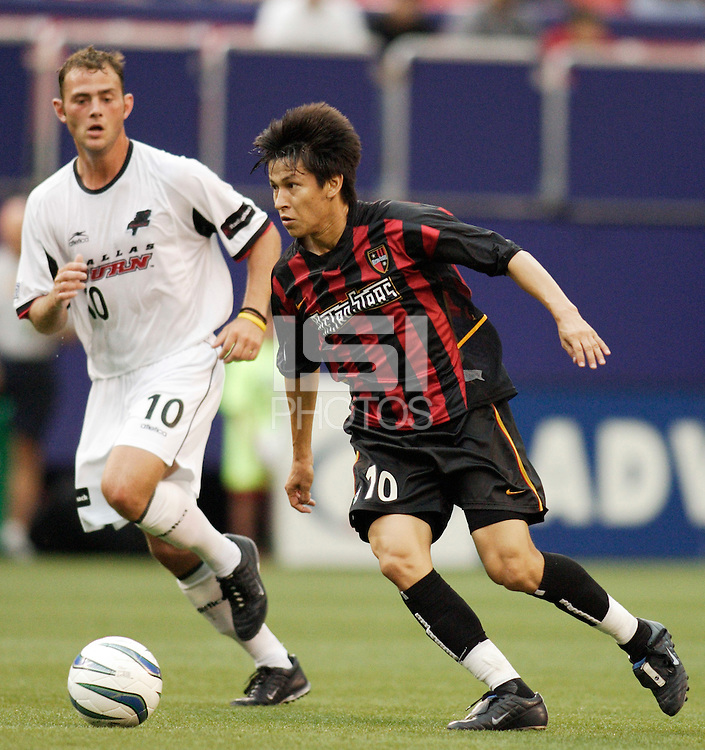 The MetroStars' Joselito Vaca is marked by he Burn's Brad Davis during first half action between the Dallas Burn and the MetroStars at Giant's Stadium, East Rutherford, NJ, on August 15, 2004.