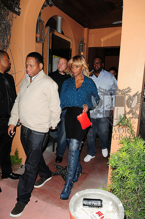 MIAMI BEACH, FL - DECEMBER 02: Mary J. Blige (R) and husband Kendu Isaacs attends Rico Loves birthday party at Vic and Angelo's South Beach on December 2, 2011 in Miami Beach, Florida. (Photo by Johnny Louis/jlnphotography.com)