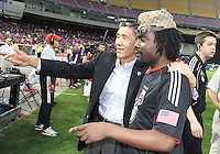 Will Chang owner of D.C. United with hip-hop star Wale during an MLS match against the New England Revolution on April 3 2010, at RFK Stadium in Washington D.C.