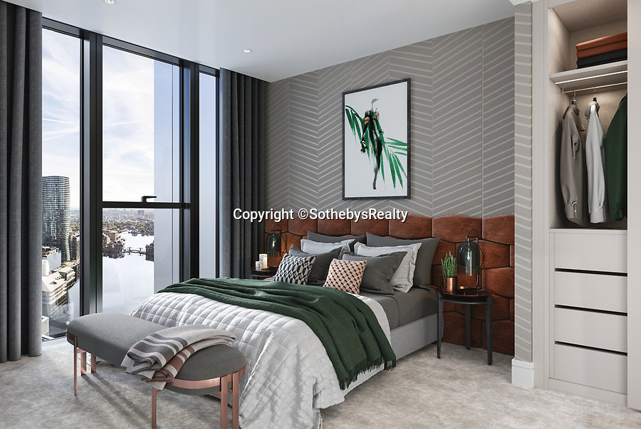 BNPS.co.uk (01202 558833)<br /> Pic: SothebysRealty/BNPS<br /> <br /> Bedroom. <br /> <br /> Is this the best view in London ...<br /> <br /> A stunning apartment offering a breathtaking panorama of the nation's capital has emerged for sale for £900,000.<br /> <br /> The stylish one bedroom flat is located on the 43rd floor of the new-build 704ft Valiant Tower in South Quay Plaza in Canary Wharf.<br /> <br /> It overlooks Greenwich and the River Thames, with London's major landmarks on display.<br /> <br /> The building has a rooftop terrace, a swimming pool and a gym, and is surrounded by waterside gardens.<br /> <br /> The flat is being sold with estate agent Sotheby's International Realty.