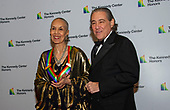 Carmen de Lavallade, left, and Charles Mirotznik, right, arrive for the formal Artist's Dinner honoring the recipients of the 42nd Annual Kennedy Center Honors at the United States Department of State in Washington, D.C. on Saturday, December 7, 2019. The 2019 honorees are: Earth, Wind & Fire, Sally Field, Linda Ronstadt, Sesame Street, and Michael Tilson Thomas.<br /> Credit: Ron Sachs / Pool via CNP