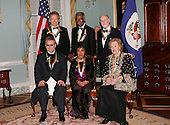 """The 2004 Kennedy Center Honorees pose for a """"Class Photo"""".  From left to right: (back row) Warren Beatty, Ossie Davis, John Williams, (front row) Sir Elton John, Ruby Dee and Joan Sutherland at the United States Department of State Harry S. Truman Building in Washington, D.C. on December 4, 2004 in Washington, DC.  .Credit: Evan Agostini - Pool via CNP"""