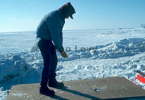 Golfer in Bering Sea Ice Golf Classic.Nome, Alaska