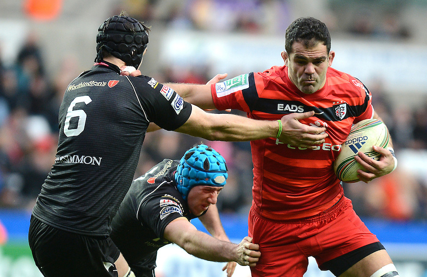 Toulouse's Gregory Lamboley pushes off Ospreys' Ryan Jones ..Rugby Union - Heineken Cup Pool 2 - Ospreys v Toulouse - Saturday 15th December 2012 - The Liberty Stadium - Swansea..© CameraSport - 43 Linden Ave. Countesthorpe. Leicester. England. LE8 5PG - Tel: +44 (0) 116 277 4147 - admin@camerasport.com - www.camerasport.com..