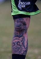 CHET JOHNSON (MTV'S EX ON THE BEACH) leg tattoo during the SOCCER SIX Celebrity Football Event at the Queen Elizabeth Olympic Park, London, England on 26 March 2016. Photo by Andy Rowland.
