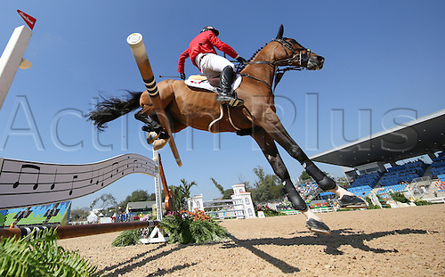 14.08.2016. Rio de Janeiro, Brazil. Yann Candele of Canada on horse First Choice hits an obstacle during the Jumping Individual 1st Qualifier of the Equestrian competition at the Olympic Equestrian Centre during the Rio 2016 Olympic Games in Rio de Janeiro, Brazil, 14 August 2016.