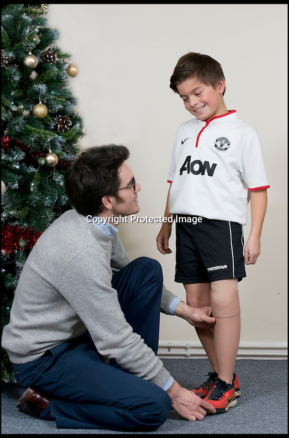 BNPS.co.uk (01202 558833)<br /> Pic: RachelAdams/BNPS<br /> <br /> Prosthetist Matthew Hughes fits Leon's new leg. <br /> <br /> Perfect gift for Xmas...A Footy nut can join in with the rest of his team for the first time this Xmas after receiving a revolutionary new prosthetic leg that  looks and feels just like an ordinary limb.Leon Meal-Moss, aged 10, had to have his lower left leg amputated when he was just eight-months-old after being born with severe deformities.The plucky youngster learnt to walk using rigid NHS false limbs which he found painful and was forced to swing his leg sideways.The schoolboy, who is a keen sports fan, was sponsored by his local football club and was bought a top-of-the-range false leg that enabled him to run in his PE classes.