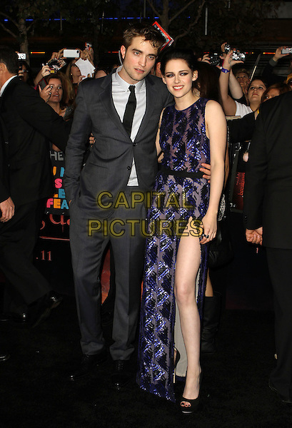 """Robert Pattinson & Kristen Stewart .""""The Twilight Saga: Breaking Dawn Part 1"""" Los Angeles Premiere Held At The Nokia Theatre L.A. Live, Los Angeles, California, USA, 14th November 2011..full length grey gray suit tie white shirt  hand in pocket blue purple sequined sequin sheer beaded dress peep toe shoes black heels couple arm around thigh leg side split slit .CAP/ADM/KB.©Kevan Brooks/AdMedia/Capital Pictures."""