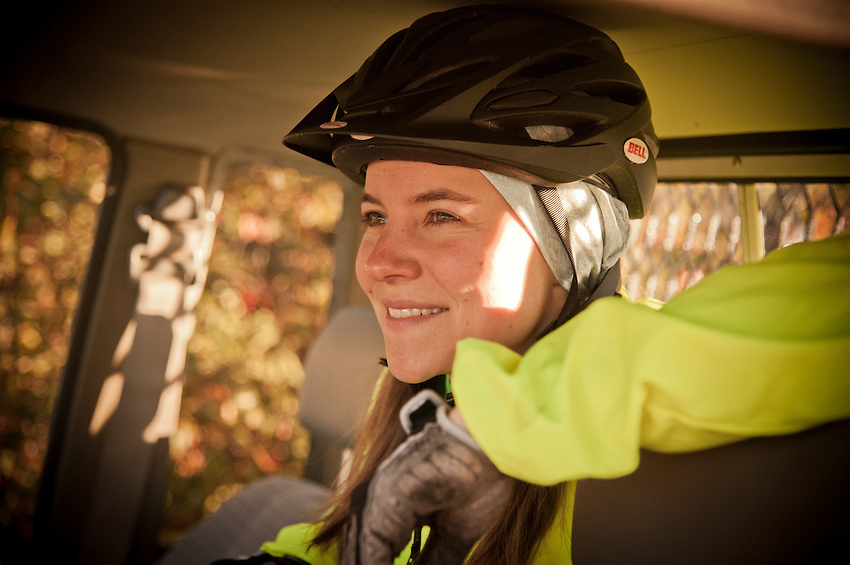 A female mountain biker smiling.
